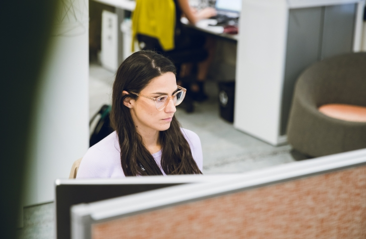 Woman sat at her desk applying for a job